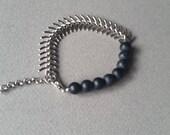 Fishbone chain with black crackle stone beads