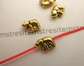 4 tiny  elephant bead antique gold