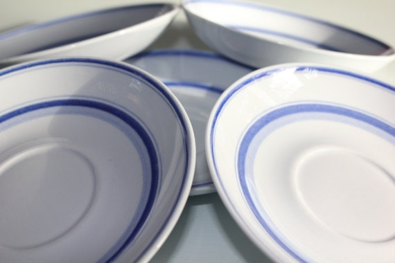 """5 replacement """"Blue Rose"""" saucers by Arabia Finland"""