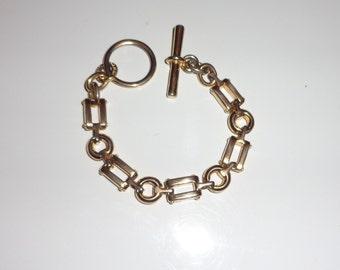 E. Pearl gold tone bracelet*