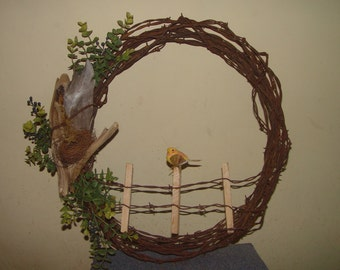 Vintage barbed wire wreath that reflects the beauty of God's world around usl