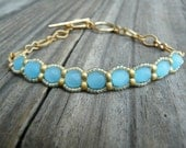 Blue Glow.  Ice Blue and Gold Beadwoven Bracelet.