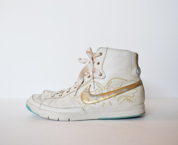 vintage 90 s nike tennis shoes high top sneakers gold and
