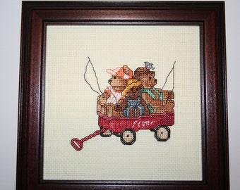 Bears in a wagon going fishing.