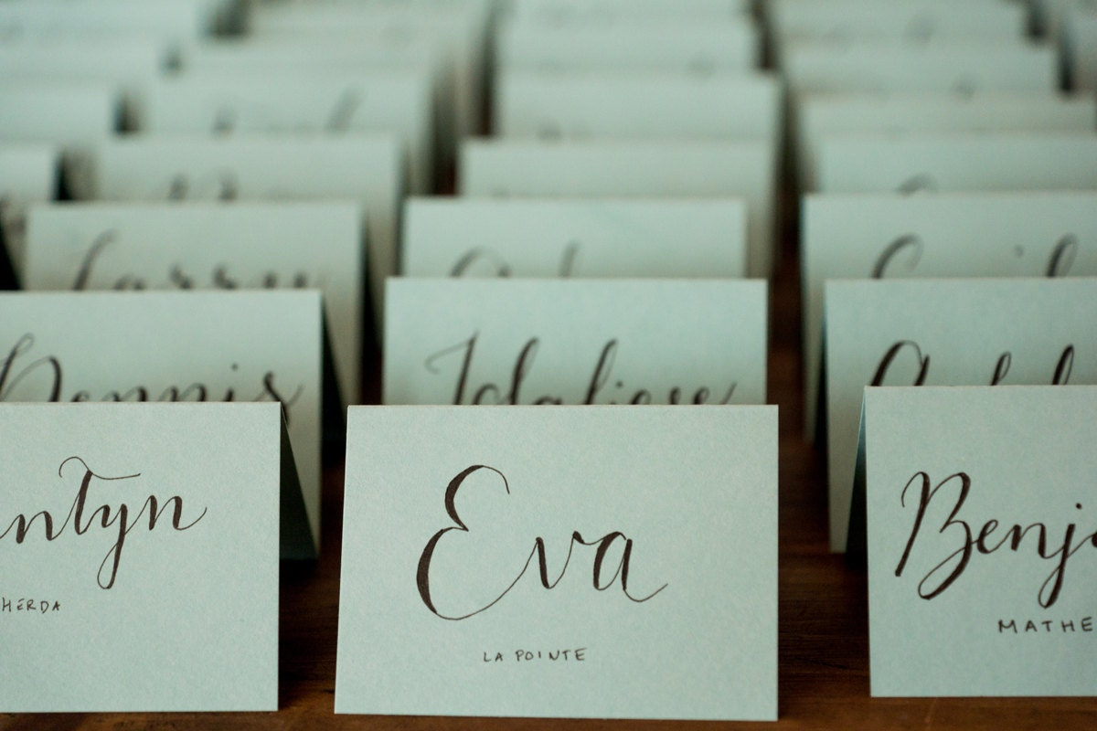 Handwritten calligraphy wedding place cards escort cards for