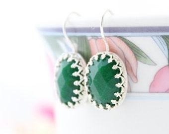 Silver earrings set with a emerald green jade gemstone, Sterling silver jewelry