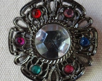 Vintage Ornate Plastic Brooch wMulti Colored Rhinestones