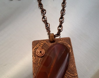 Amber Agate stone cold connected to etched copper base plate