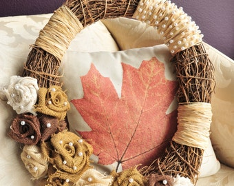 20x17 Oval Wreath. Accented with Handmade Burlap and Canvas Roses, Raffia, and Pearls. Neutral Colors- Cream, Tan, and Chocolate Brown.