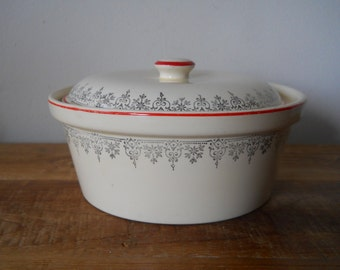 Ornate Casserole with Scrolling Design and Red Rims