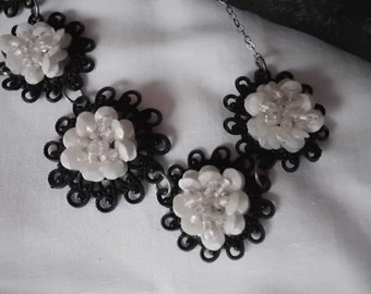 Vintage 1950s black and white filigree and flower necklace
