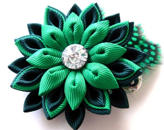 Kanzashi fabric flower hair clip with feathers.  Shade of green. Hair clip with feathers.