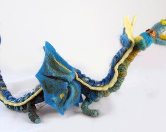 Wool dragon doll interactive sea blue green, and lemon colored. Needle felted wool + yarn & suitable for play or decoration. 18x6x10 inches