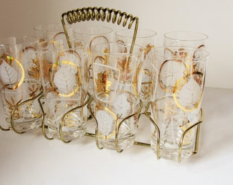 "Set of Eight Glasses in Ball Foot Holder - Gold and White Leaves Against a Clear Glass With 3/4"" Solid Glass Bottom - Goldtone Carrier"