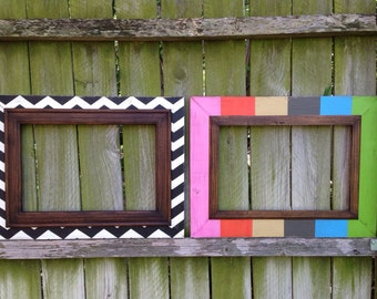 set of two distressed 12x18 frames in black & heirloom chevron and multi wide stripe ~both with dk stained walnut trim