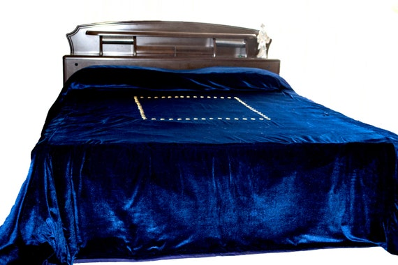navy blue bedcover with gold sequin hand
