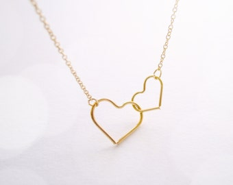Dainty two heart necklace in gold