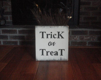 Trick or Treat rustic sign hand painted on a piece of new pine