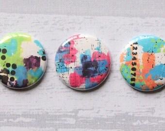 "3 badges 1 ""Mixed Media (design Egwu)"