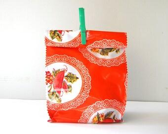 Oil cloth lunch bag in orange doily
