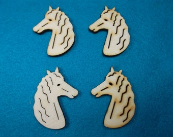 4  horse heads, wood, 4 x 3 cm (10-0027B)