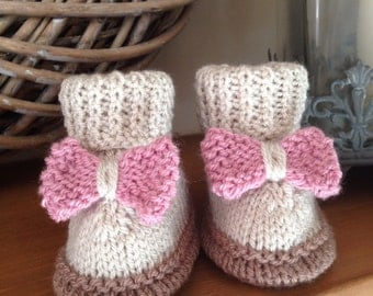 Adorable knitted baby boots with knitted bow detail