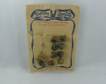 Supreme quality. 10 ancient GLASS buttons on original cardboard. Made in Germany US-Zone. Vintage