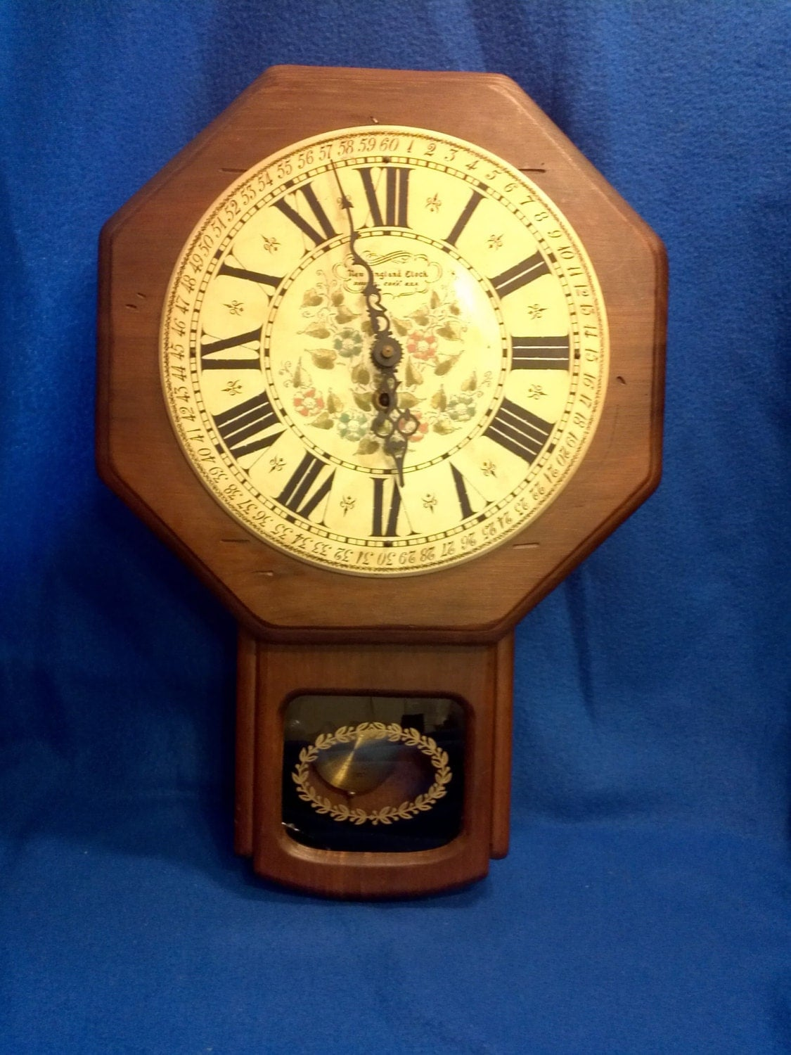 A New England Clock Co Wind Up Wall Clock