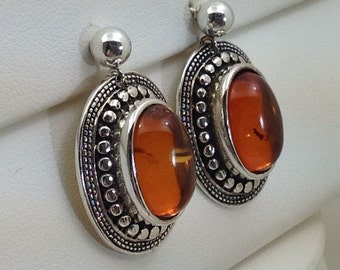 Sterling oval amber dangle earrings.
