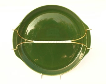 Green ceramic serving tray with brass handle and white vinyl roping grip