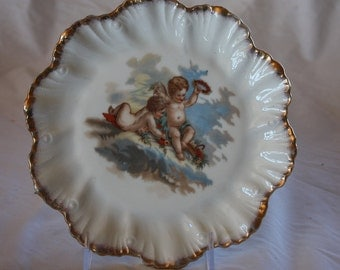 Beautiful Antique Scalloped Edge Cherub Plate with gold accents 8 3/8""