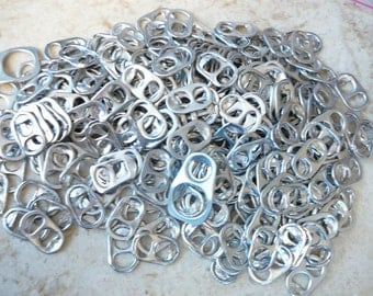 lot of 300 aluminum can tabs silver in color
