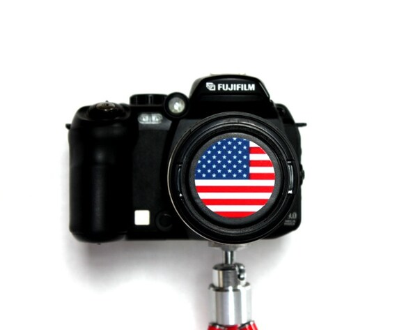 U.S flag camera lens cap for Canon, Nikon, Fuji, Sony etc. DSLR, mirrorless and point and shoot cameras. Free shipping in North America.