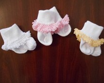 Baby and toddler socks with delicate hand crochet trim. White socks with lacey and frilly edge of pink, yellow or white.