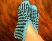 Knitted wool slippers, blue and black booties. Warm and cozy ankle socks for women