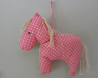Pink spotty pony.A hanging decoration for a childs room