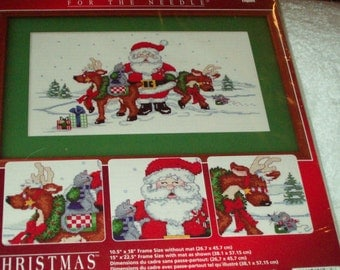"Designs for the Needle, Santa and deer.  Finished size 10.5"" x 18""."