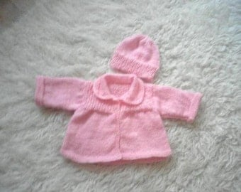 Sweet knitted baby jacket and hat in pink
