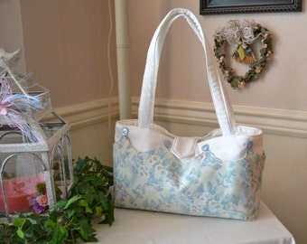 Pastel colored cover with white base purse