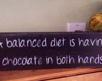 A balanced diet is having chocolate in both hands