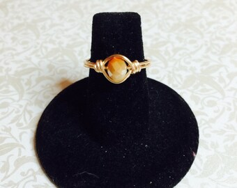 Peach and opaque crystal ring