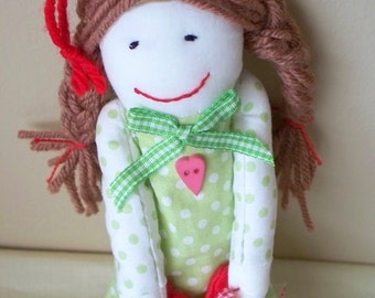 Handmade fabric or cloth doll Bettina, Rag Doll dressed in green dress with white polka dots