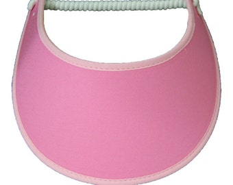 Pink visor with fabric trimmed edges.