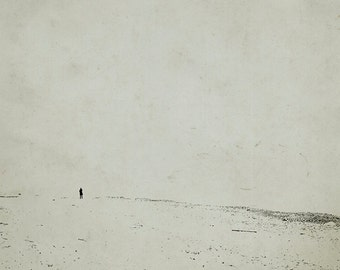 Small figure in black and white. sea photography. print