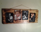 Hand made burnt wooden picture frames. With 4x6 pictures set into the wood