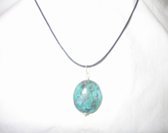 large turquois stone on leather