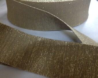 2 in wide gold shimmer elastic webbing, shimmery elastic