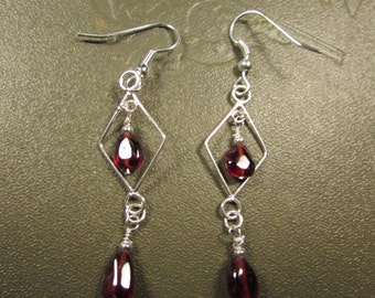 Sterling Silver chandelier Earrings with Garnet beads.