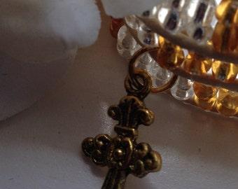 Celtic Cross Triple Wrap Beaded Bracelet - Gold Beads Ivory Cotton Cord & Gold Filigree Metal Clasp Celtic Jewelry, Womens Fashion Jewelry