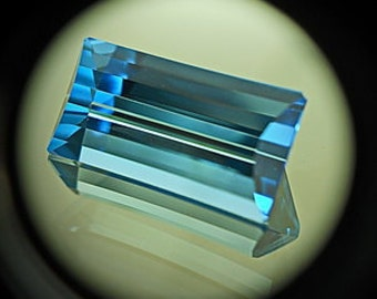 Blue Topaz | 7.45ct | Precision Cut |  Long Baguette Shape Gemstone. Mirror Type Spark Goes Into One Direction. Eye Catching Stone
